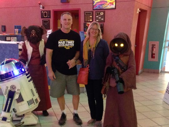 Scott and Karen Guisbert with Star Wars characters before watching a recent Star Wars movie in theaters.