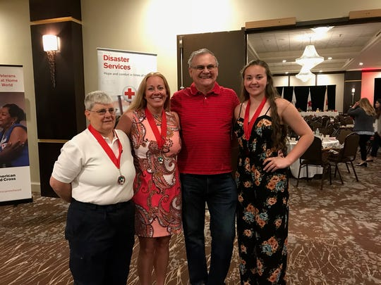 SUe SHove, Lila Harris, Bruce Dailey and Oliviah Harris-Morris pose following the Real Heroes Breakfast Thursday morning.