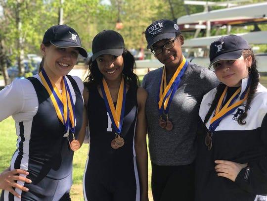 Members of the Poughkeepsie High School girls crew