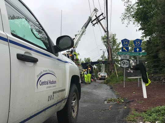 A Central Hudson Gas & Electric Corp. crew works to replace a utility pole at an intersection in Fishkill.