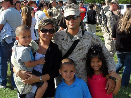 Staff Sgt. Javier Ortiz-Rivera with his wife Veronica, Alyssa Jade, 8, Andrew Joshua, 5, Anthony Javier, 3, before his deployment to Afghanistan in September 2010. He was killed in November of that year by a roadside bomb. He will be remembered on Sunday at Charlotte Motor Speedway as part of a NASCAR event for Memorial Day Weekend.