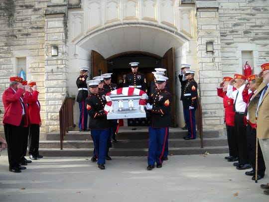 Marines carry the flag-draped casket of Marine Cpl.