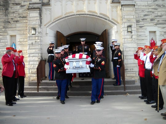 Marines carry the flag-draped casket of Marine Cpl. Tevan Nguyen, killed Dec. 28, 2010, in Afghanistan, down the steps of St. Mary's Catholic Church in Brownwood.