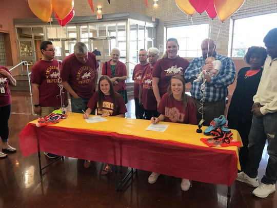 Burkburnett's Olivia Johnson and Lorrin Peigne signed
