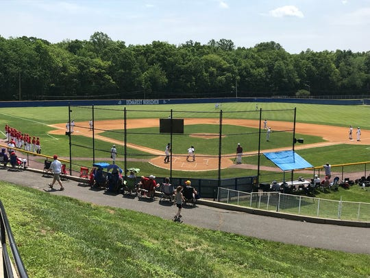 Don Bosco (in white) and Bergen Catholic (in red) warm up for their Bergen County baseball semifinal at NV/Demarest on Saturday, May 26, 2018. Don Bosco won, 13-3, in six innings.
