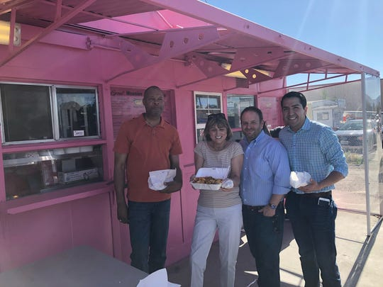 State Sen. Aaron Ford, D-Las Vegas, ex-NevadaTreasurer Kate Marshall, businessman Zach Conine and Assemblyman Nelson Araujo, D-Las Vegas, pictured outside Yvonne's Hot Dogs in Fernley on Friday, June 1