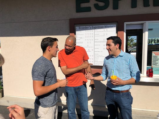 State Sen. Aaron Ford, D-Las Vegas, and Assemblyman Nelson Araujo, D-Las Vegas, chat with Tyler Dennis during a campaign stop at Broeder's Espresso in Fernley on June 1, 2018.