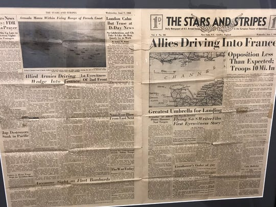 "Howard Games donated this framed copy of the June 7, 1944 edition of ""The Star And Stripes,"" which he bought for a penny at his U.S. Army Air Corps base in England the day after D-Day, to Corban University."