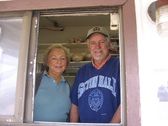 Beverly and Gerald LaCrosse at the window of their Der Wunder Weiner hot dog stand in 2009.