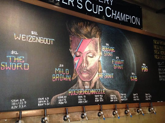 Creative director and taproom manager for Bier Brewery Sarah Buschmann creates chalk art to display the brewery's weekly rotating beer list.