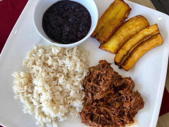 Pabellón criollo from Fusion 212 at Miromar Outlets in Estero. The traditional Venezuelan dish is a plate of shredded beef, black beans, white rice and fried sweet plantains.