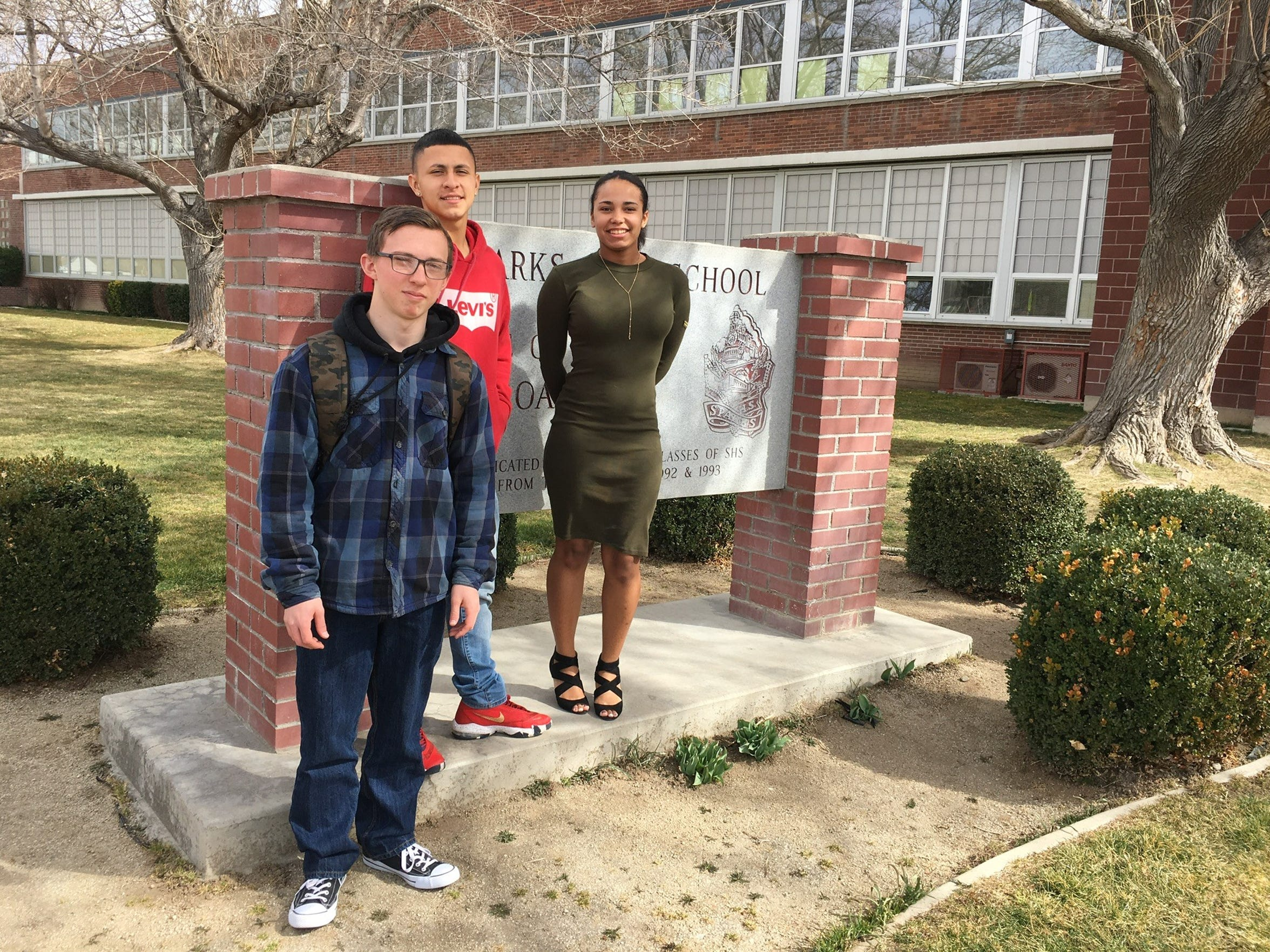 2018 Sparks High grads Neil Penrod, Justin Fuentes and Elizabeth Long stand outside of their school. The three were students at Sparks Middle School in 2013, when a student shot and killed a teacher, shot and injured two students and killed himself with a gun he brought to school from home.