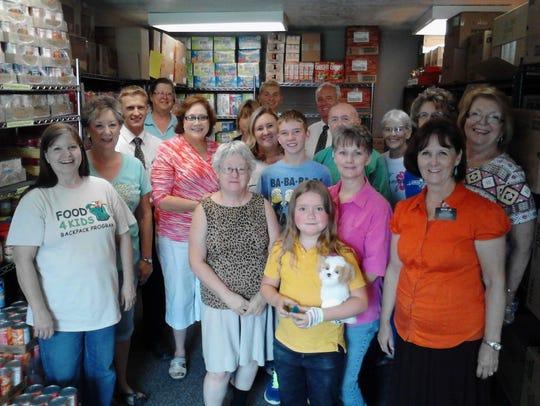 Volunteers spend many hours  helping Food4Kids each
