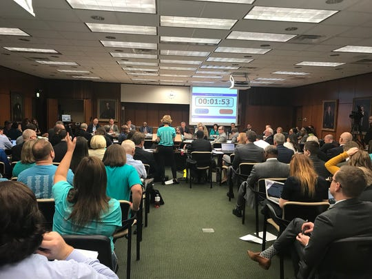 People fill the room during the Michigan State University Board of Trustees regular meeting on Friday, June 22.