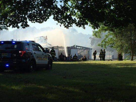 Authorities respond to fire on Cedar Swamp Road in