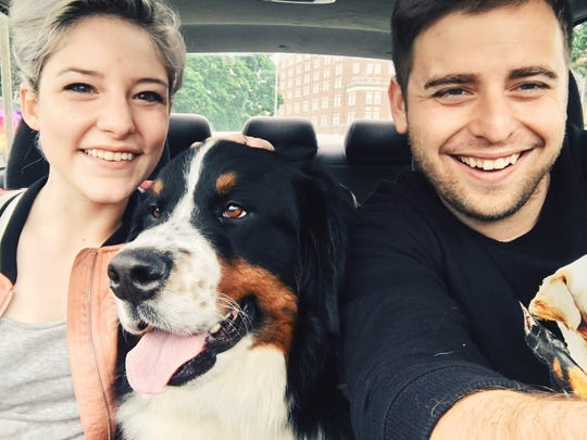 Hanna and Nick Landrum with Lola, a friend's dog they watch.