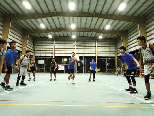 636661850244146166-U14-Sinajana-Rockers-Darren-Cepeda-attempts-a-free-throw-against-Barrigada-Crusaders-Grey.JPG