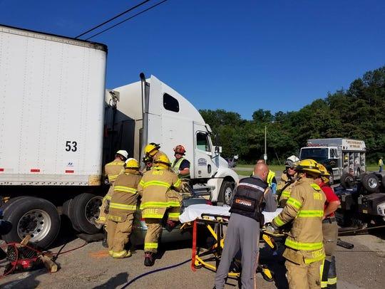 Rural/Metro firefighters work a crash involving a car