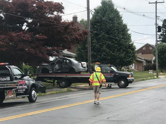 A vehicle is loaded onto a truck after a crash in Dallastown on Friday, July 6.