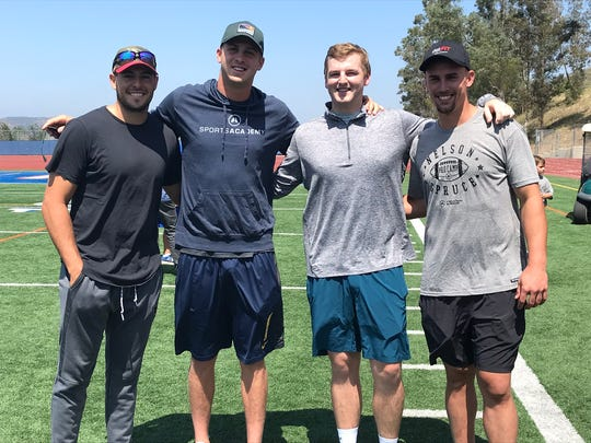NFL quarterbacks Mike Bercovici, left, and Jared Goff, second from left, pose with Chargers receiver Nelson Spruce, far right, during the first Nelson Spruce Pro Camp at Westlake High on June 23.