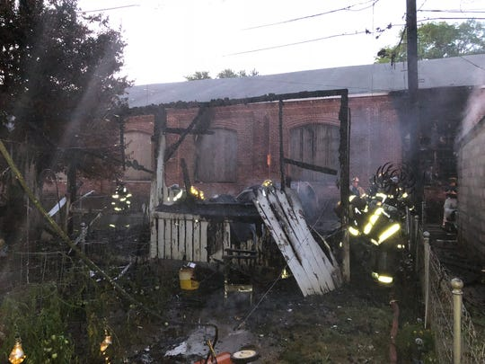 York City firefighters fought a garage fire in the