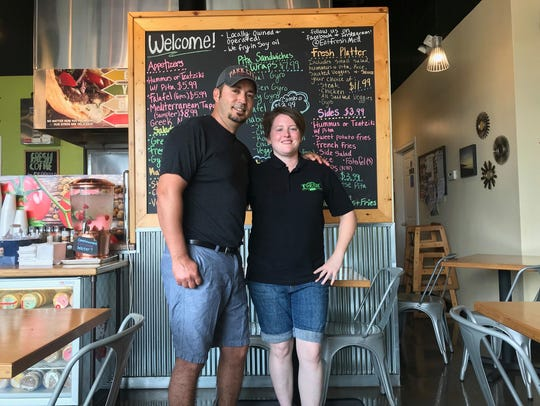Hassan Atarmal, owner of Fresh Mediterranean Express in Waukee, stands with the Iowa Restaurant Association's Employee of the Year award recipient, his employee Shayna Watts/