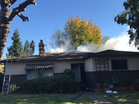 Redding firefighters are battling at least two structure