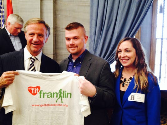 Gov Haslam and Wellness Champions Michael and Christa Gonzales.JPG