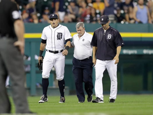 Detroit Tigers left fielder Mikie Mahtook walks off the field after a play during the fourth inning of a baseball game against the Minnesota Twins, Friday, Sept. 22, 2017, in Detroit. (AP Photo/Carlos Osorio)
