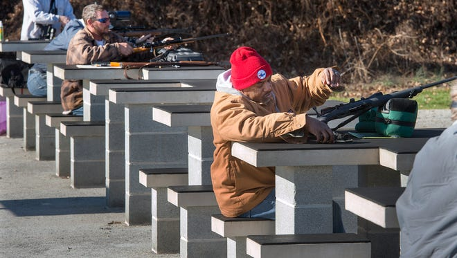 Keith Williams, right, of Fairview Township, practices at the State Game Lands No 242 shooting range in Warrington Township. Rifle deer hunting season opens Monday and continues through Dec. 12.