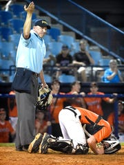 Palymra catcher Nick DeCarlo bends down in pain during the District Three Class AAA title game Thursday at Reading's First Energy Stadium. The Cougars lost to Hamburg, 7-0.
