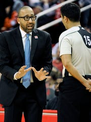 Memphis Grizzlies head coach David Fizdale, left, talks with official Zach Zarba in the first half of an NBA basketball game against the Houston Rockets, Saturday, March 4, 2017, in Houston.