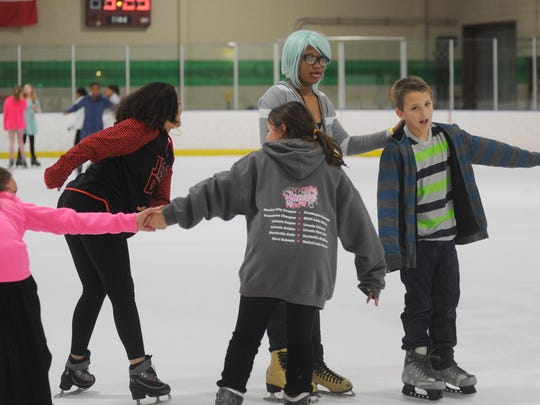 The Farmington Hills ice arena held a skating party as part of the After School program's 20th birthday party.