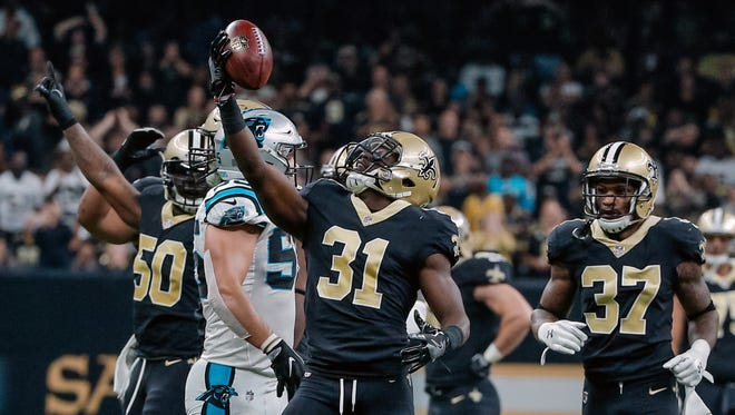 New Orleans Saints cornerback Chris Banjo (31) celebrates after a defensive stop against the Carolina Panthers during the second quarter at the Mercedes-Benz Superdome.