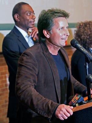 Actor-director Emilio Estevez speaks at a news conference with Cincinnati Mayor Mark Mallory, left, Thursday, Oct. 25, 2012, in Cincinnati.