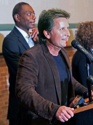 Actor-director Emilio Estevez speaks at a news conference with Cincinnati Mayor Mark Mallory, left, Thursday, Oct. 25, 2012, in Cincinnati.