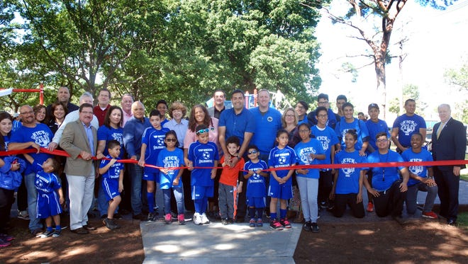 Union County Freeholder Chairman Sergio Granados and freeholders Linda Carter, Christopher Hudak and Bette Jane Kowalski join Elizabeth Mayor J. Christian Bollwage, Union County Manager Alfred Faella and members of the Elizabeth City Council and Board of Education in cutting the ribbon officially opening Union County's first inclusive public playground in Mattano Park in Elizabeth in October, 2016. The ceremony took place during Union County's Family Fun Day in the park. Fun for all ages and abilities, the inclusive playground at Mattano Park features a variety of accessible play equipment including a Merry-Go-All, Roller Slide, Roller Table, Swing Seats, and more.