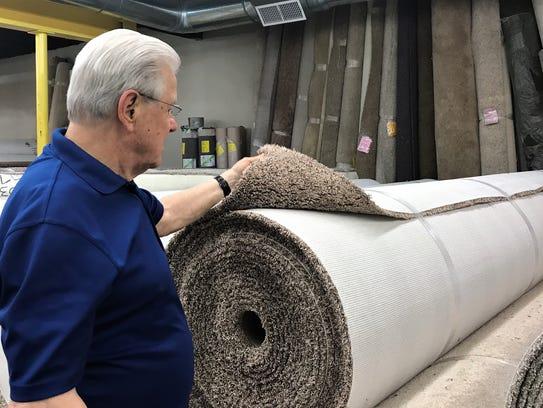 Ronnie Walcott, owner of Aladdin's Flooring, looks