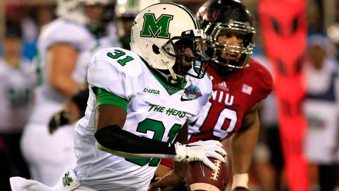 Marshall quarterback Rakeem Cato runs with the ball.