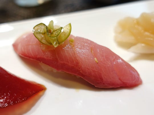 Hamachi nigiri sushi with pickled jalapeno at Sushi