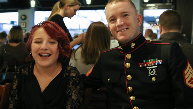 Staff Sgt. Brian D. Raney and Raven Campbell eat dinner at The Alley on Main in Murfreesboro before the Girl Scout father-daughter dance. Many people donated things to make the evening special for Raven and Raney, including dinner at The Alley, a limo ride, admission to the dance, photos and a dress.