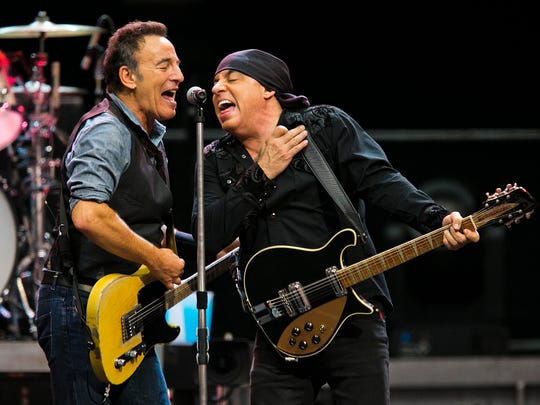 Bruce Springsteen , left,  with Steven Van Zandt, right,