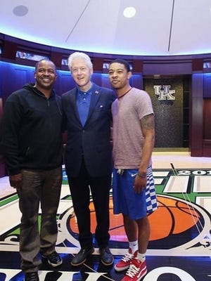 President Bill Clinton poses with James and Tyler Ulis on Tuesday in the UK men's basketball locker room.