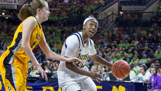 Notre Dame Fighting Irish guard Jewell Loyd (32) dribbles the ball around Valparaiso Crusaders guard Jessi Wiedemann (44) in the second half of the game at Joyce Center.