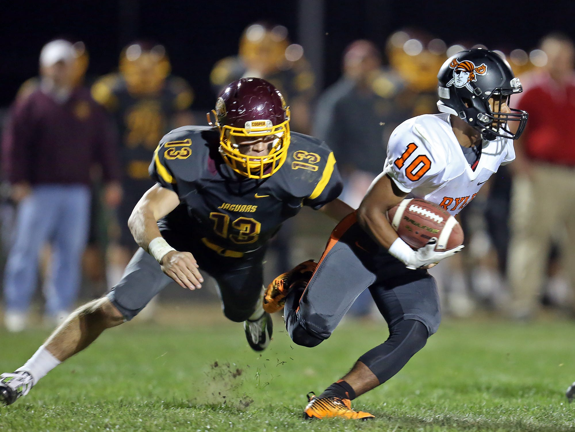 Cooper DB Justin Schlarman brings down Ryle KR Eric Wright for no gain on the return.