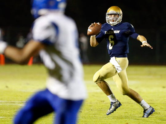 Salesianum quarterback Garrett Cannon looks for a receiver in the second quarter of the Sals' 20-6 win at Baynard Stadium Friday.