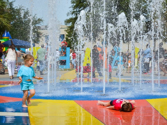 This Advertiser file photo shows children cooling off