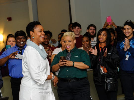 Local Popeye's employees meet and with Deidrie Henry,