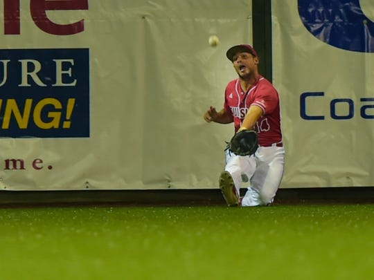 UL centerfielder Kennon Fontenot sledes for a ball at the wall as the the Cajuns beat Princeton 5-3 in the first round of the NCAA Regional Tournament at Tigue Moore Field.