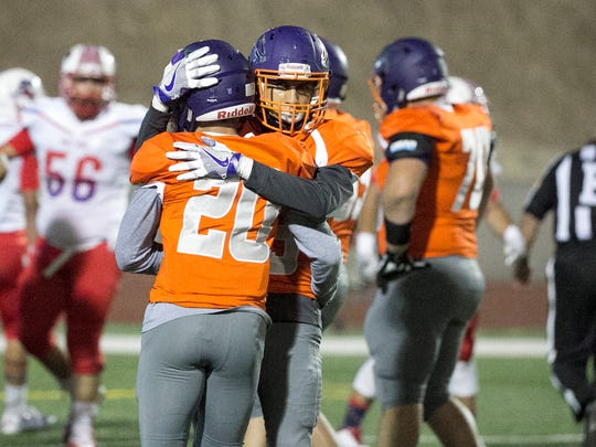 Eastlake running back Ivan Avina, 20, is congratulated by a teammate after scoring a touchdown against Bel Air Thursday night.